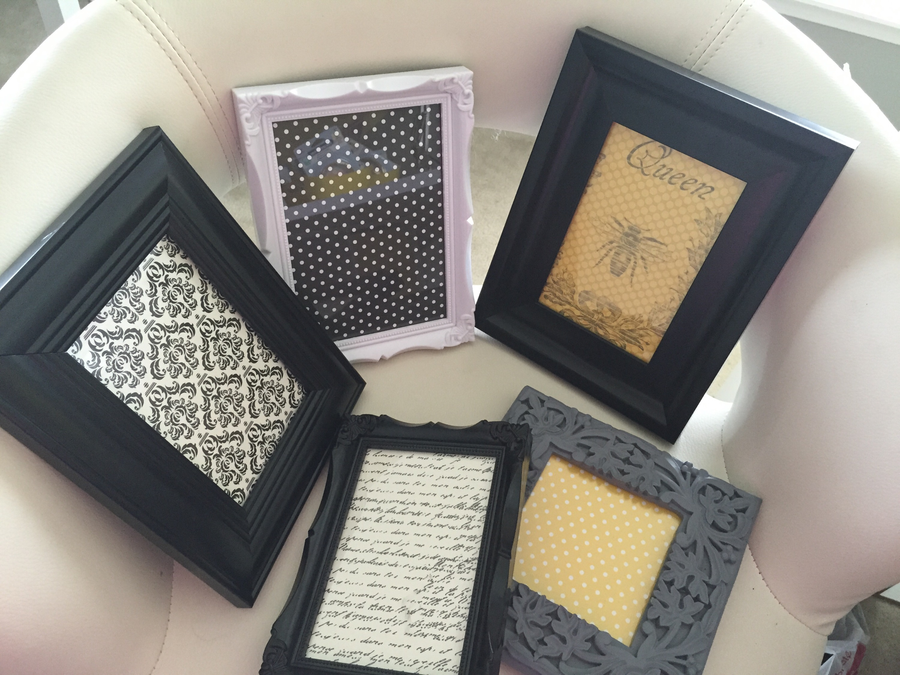 i then put them into the picture frames that i had bought from joanns the paper was 10 pieces for 2 and the frames were 50 off each
